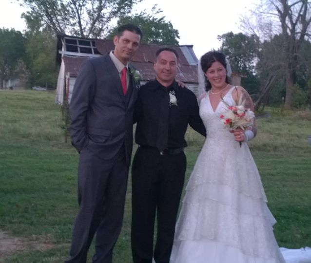 Officiant with the bride and groom