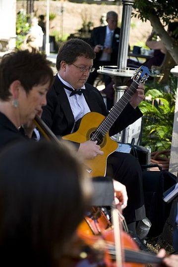 Violin, cello, and guitar trio.  Perfect for the outdoor garden wedding!