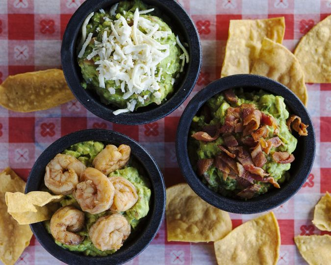 Fresh guacamole with toppings