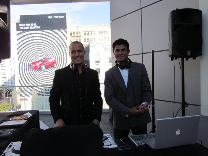 DJs Dustin Fuselier and Sergio Penaloza at a rooftop wedding in downtown Los Angeles