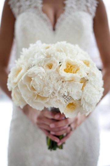 Ruffly and romantic with a little touch of bling! Garden roses and carnations