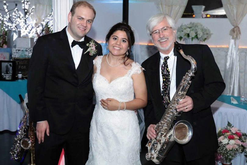 Newlyweds with the saxophonist