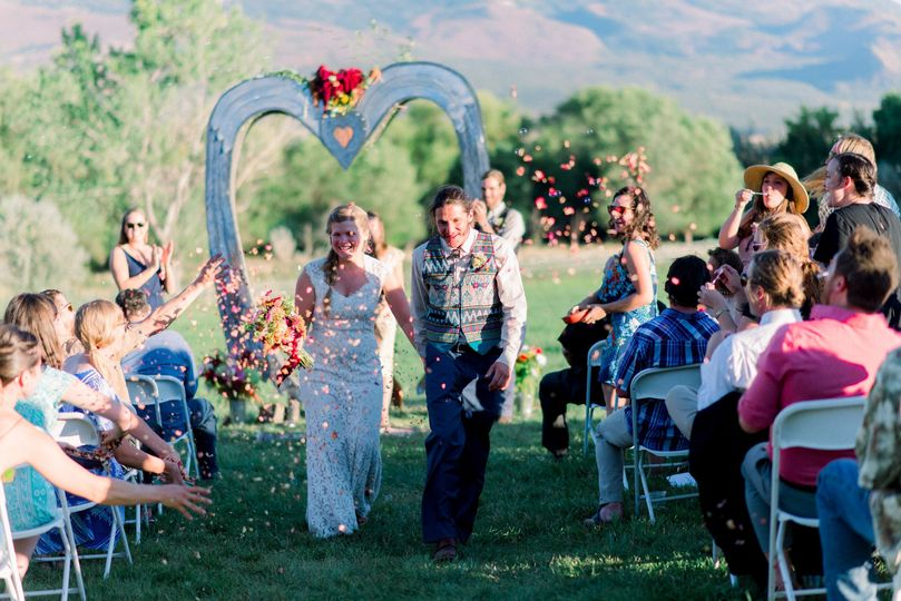 Outdoor ceremony with heart arch