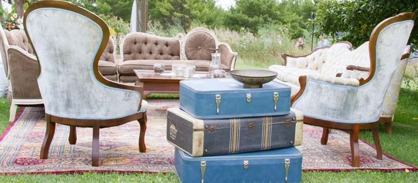 light blue chairs with luggage side table