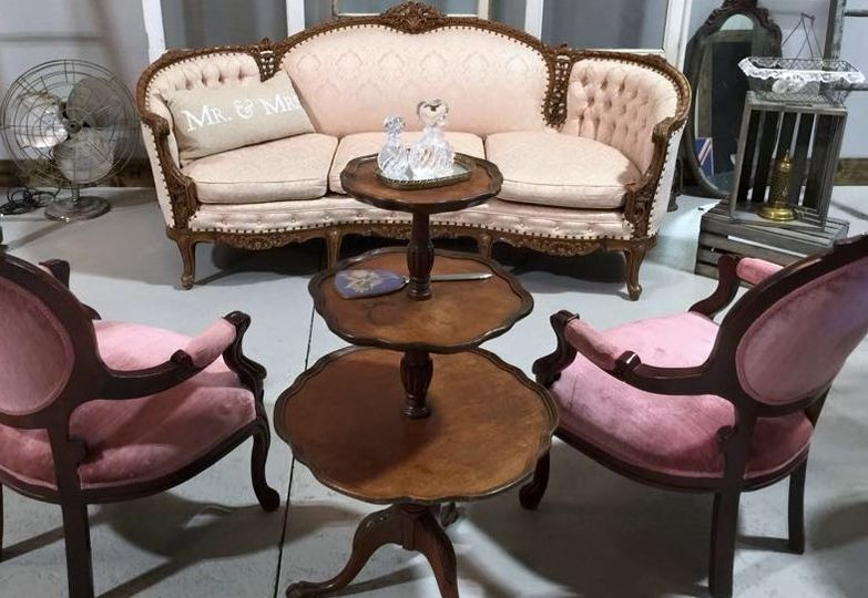 ivory sofa with two pink upolstered chairs and thr