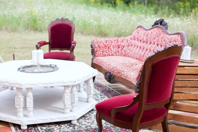 red and white loveseat with two red upolstered cha