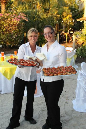 Servers passing hor'dourves during cocktail hour on the beautiful beaches of Captiva.
