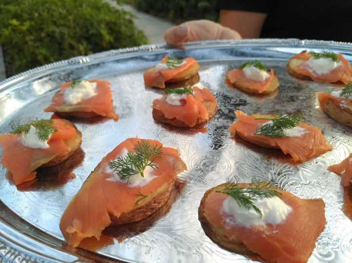 Delicious, bite-sized smoked salmon on a potato wedge for cocktail hour.