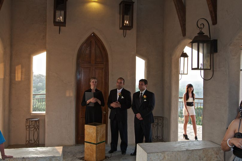 Officiant waiting with the groom