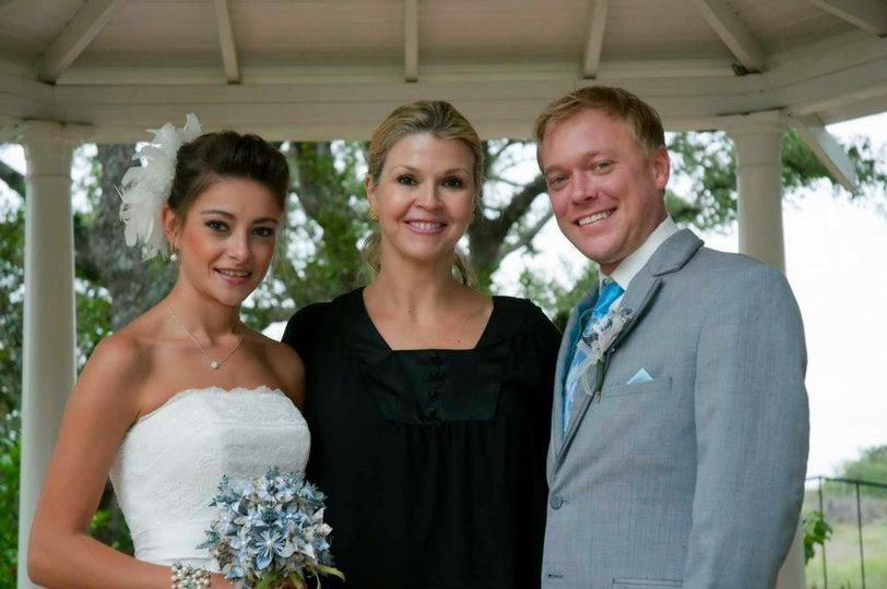 The officiant and the newlyweds