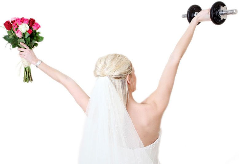 Bride with bouquet and dumbbell