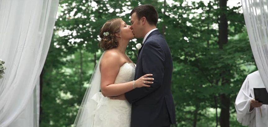 bride kissing groom in cleveland wedding