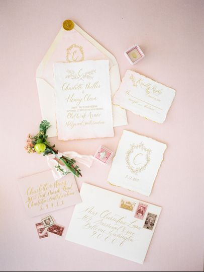 Romantic pink and gold invitation suite with bespoke wedding crest, watercolor washed and gold hand...