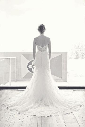 Vanya designs dress attire wichita ks weddingwire for Wedding dresses wichita ks