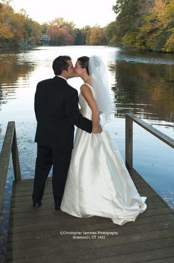 B&G kissing at the lake