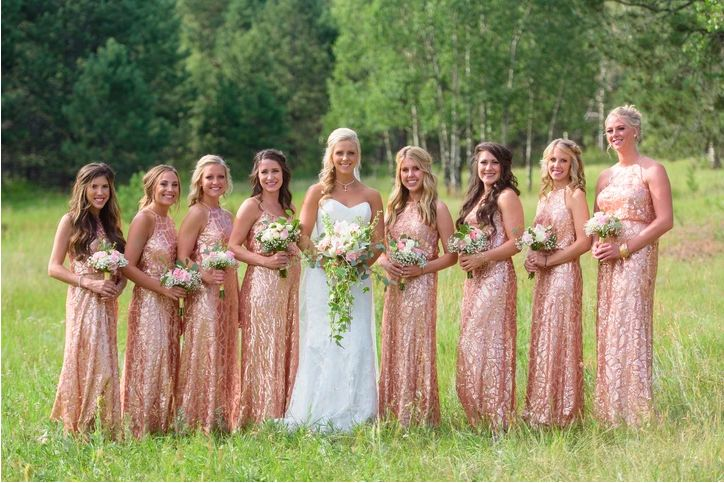 Bridal party posing with fresh bouquets