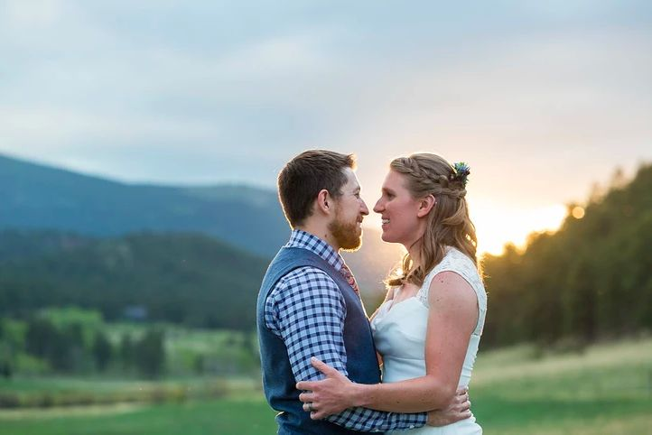 Newlyweds together in a pasture