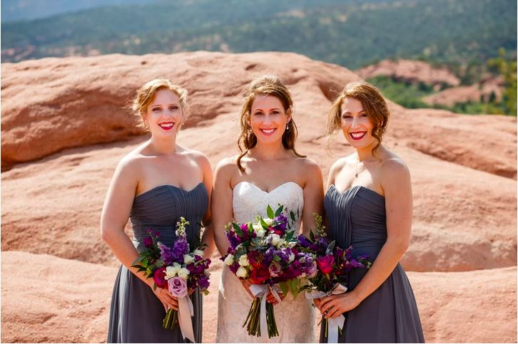 Bride and bridesmaids posing outside