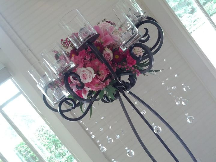 Candle and flower arrangement
