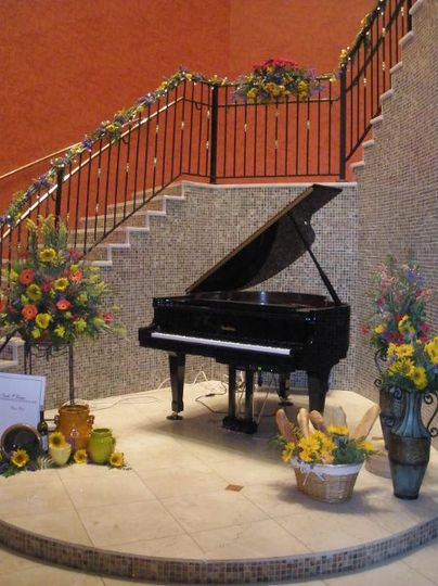 Baby Grand Piano and Marble Staircase