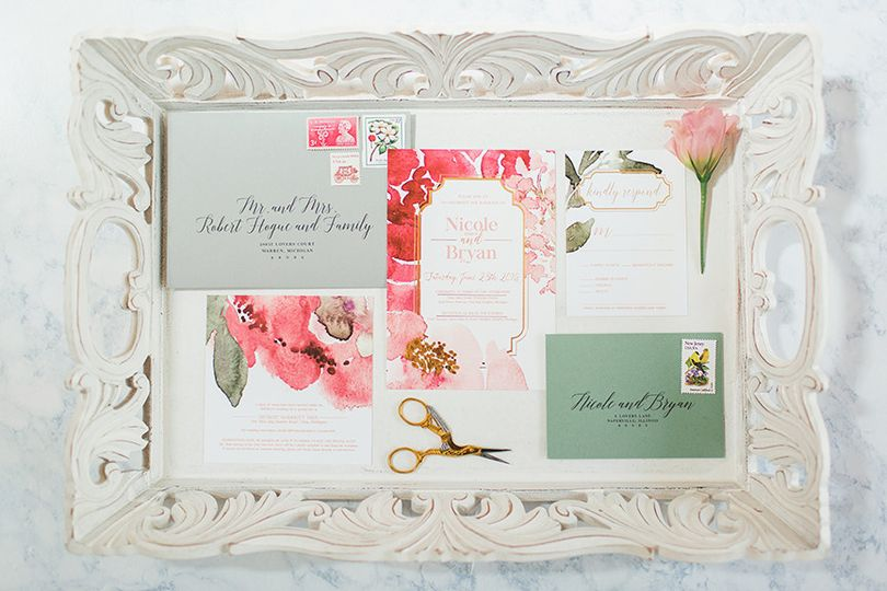 A bold watercolor floral with a gold accent sets the tone for this elegant wedding. Accented by...