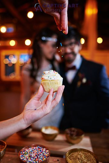 Couple looking at cupcake