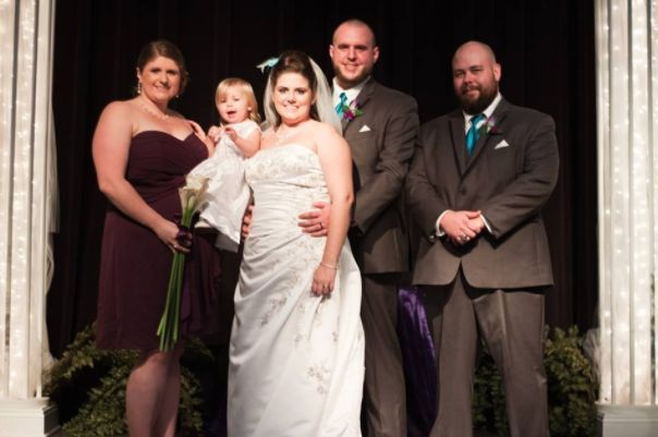 The couple with the bridesmaid and groomsman