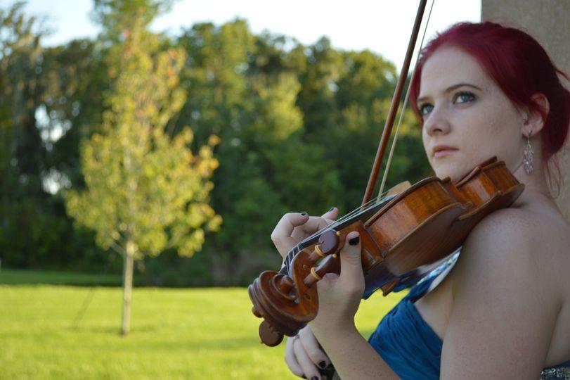 Kristen Monnik playing music outdoors