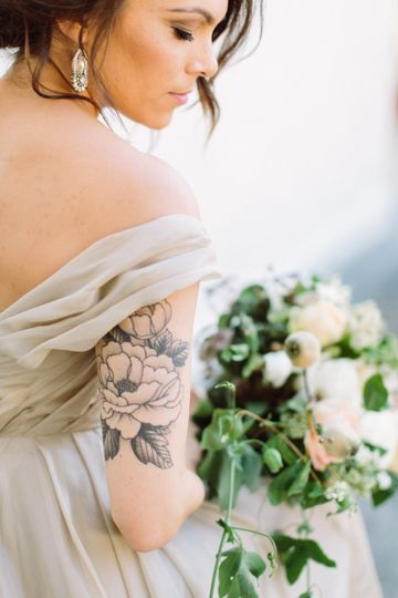 Bride's tattoo and bouquet