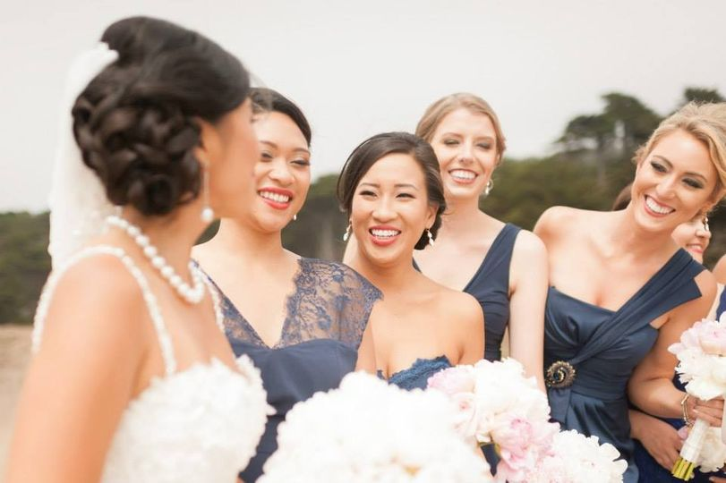 All smiles from the bridesmaids for the bride