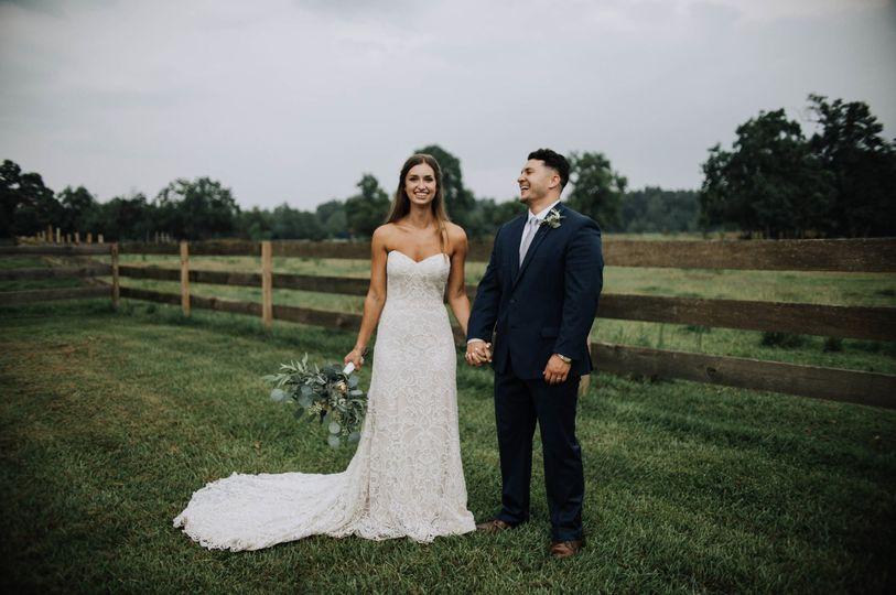 Couple posing in a field