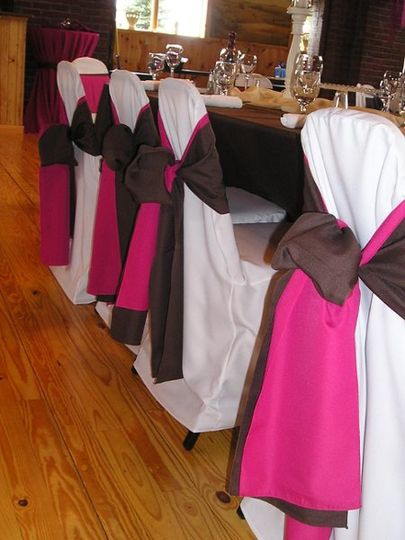 White chairs with black and pink bow