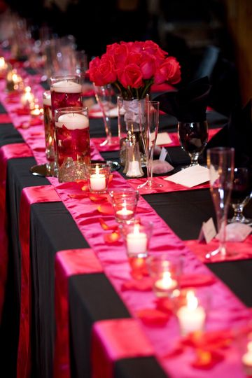 Black and pink table setup with candles