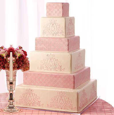 Pink and white square wedding cake
