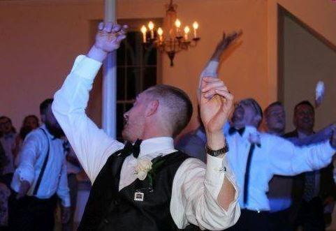 Groom tossing the garter