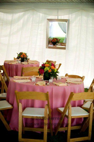 Pink tables and wooden chairs