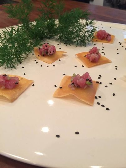 Fresh tuna tartar on sesame wonton crisp