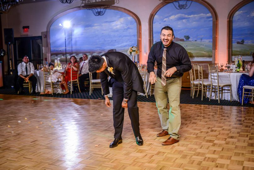 Aaron and DJ Lunatiko are having too much fun prepping for the garter removal! Image courtesy of...