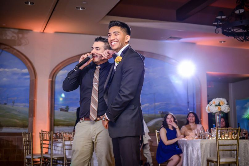 Giving the groom a crash course on proper Garter Removal etiquette. Picture courtesy of...
