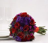 This beautiful red rose & lisianthus bridal flower collection comes different quantities such as 10,...