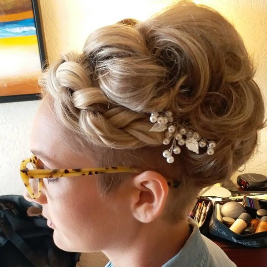 Curled up-do with simple hair ornament