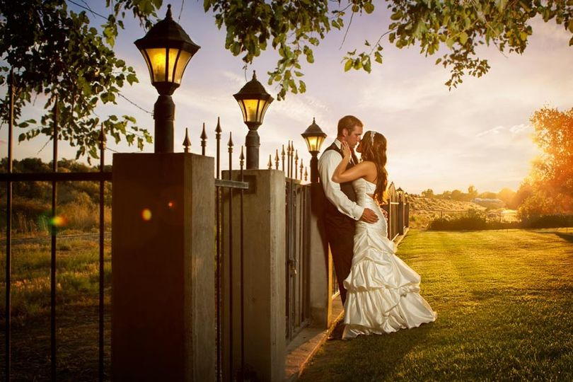 Wedding couple kissing during sunset at Moore Mansion in Pasco, Washington