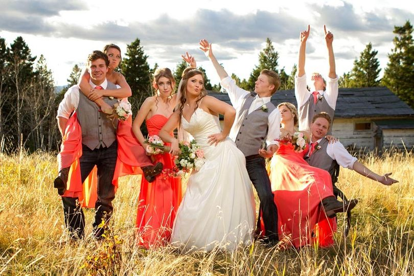 The wedding party makes a crazy pose in Kamloops, British Columbia, Canada