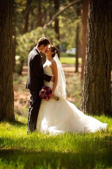 Bride and Groom kiss in the forrest near Edgewood in Lake Tahoe, California
