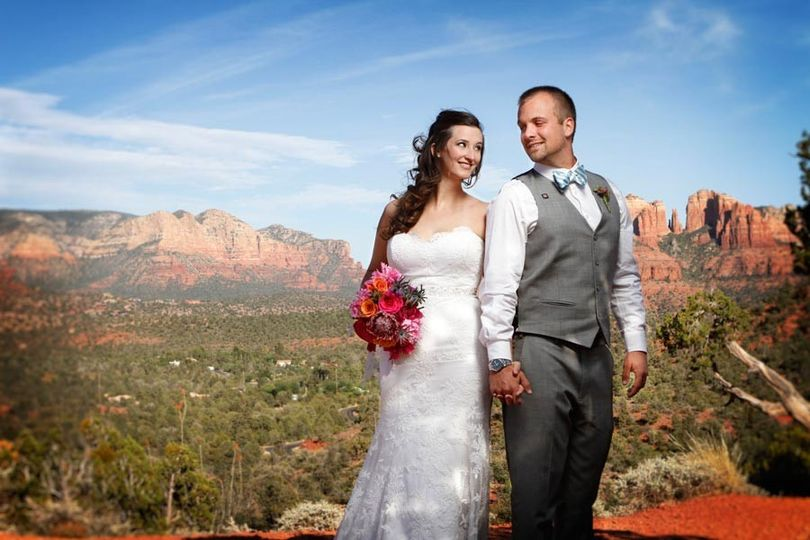 Bride and Groom with overlook of Red Rock State Park in Sedona, Arizona