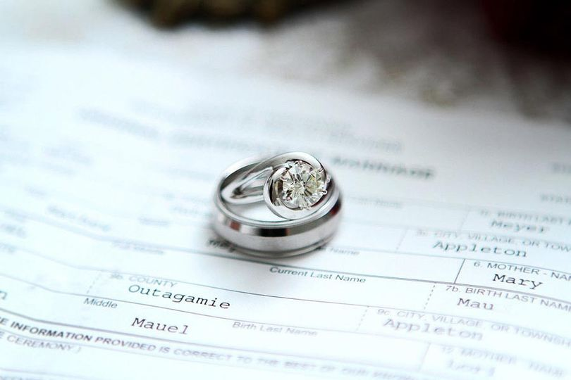 Closeup view of rings and marriage license in Appleton, Wisconsin
