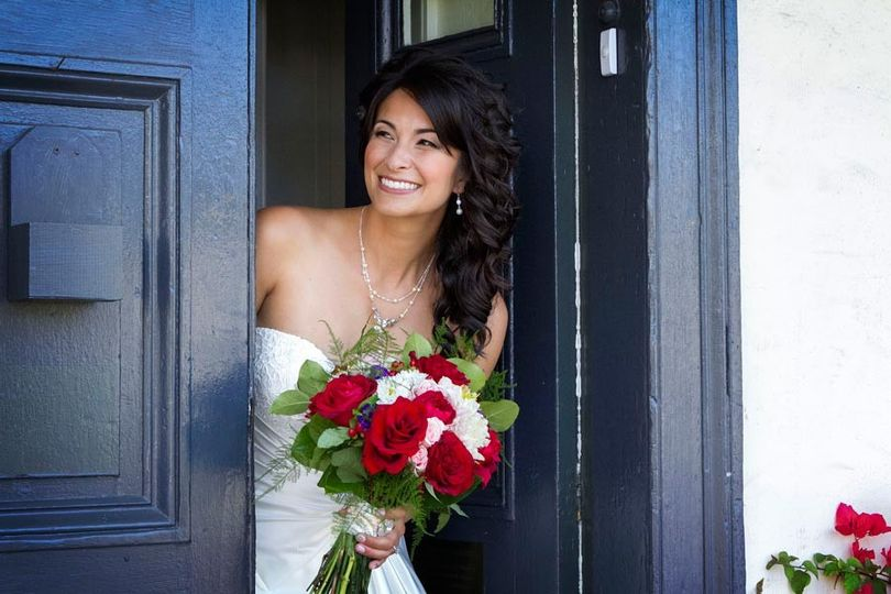 Bride peers around corner to see Groom at the Old Whaling Station in Monterey, California