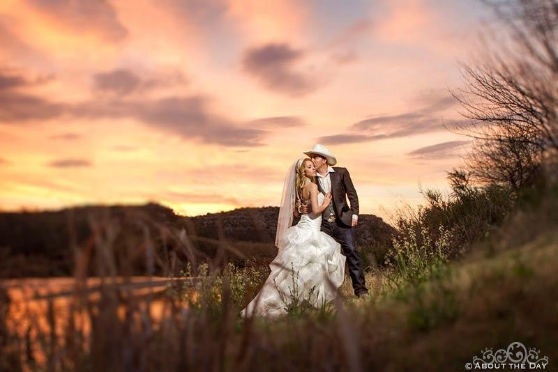 Bride and Groom kiss in the sunset overlooking the Rio Grande River near Del Rio, Texas