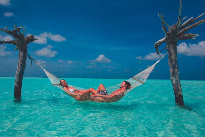 Enjoying your own hammock in the Maldives, one of Unforgettable Honeymoons top spots for overwater...