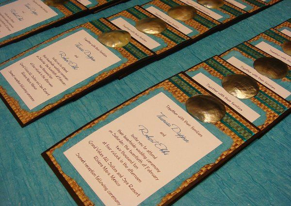 Custom Beach Wedding Invitation with a shell and Ribbon Embellishmnt.  Hand woven Bamboo Paper is...
